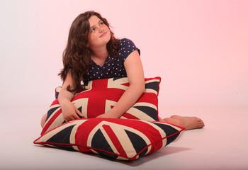 Brunette girl hugging pillow
