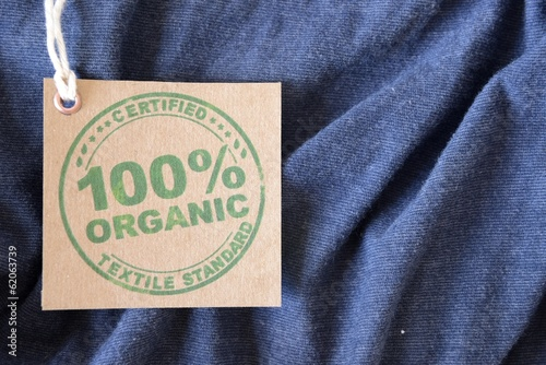 Blue garment made with certified bio or organic fabric label.