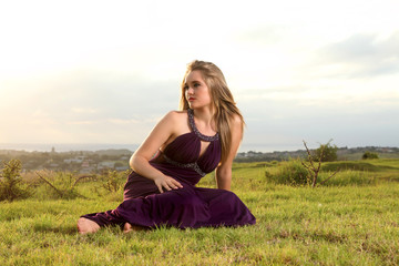 Attractive blonde lady on hill over town