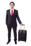Businessman standing with a luggage, isolated on white