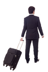 Businessman walking with a luggage, isolated on white