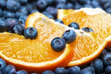 Freshly picked blueberries with orange