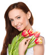 Young woman is holding bouquet of tulips