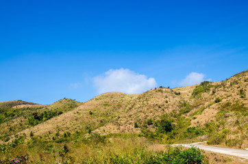Dry mountain against blue sky