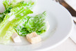 Cos lettuce with chicken ham in a white plate