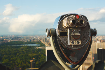 Binoculars telescope overlooking Central Park