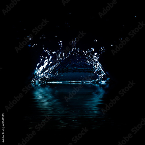 Water splash isolated on black background.