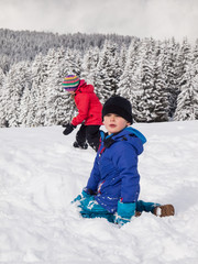young children playing in the snow