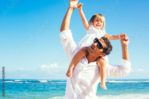 Father and daughter having fun together at the beach