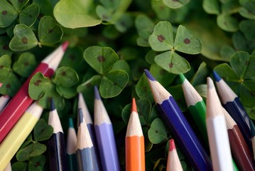 peaks of crayons with clovers