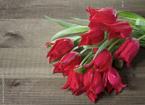 Bouquet of tulips on a wooden background