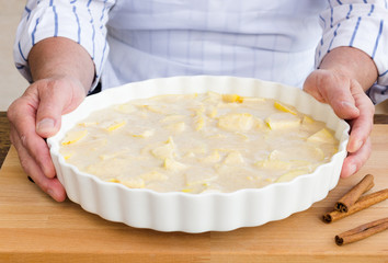 Man preparing an apple pie