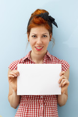 Pin-Up Girl holding blank card with copy space