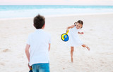 Kids playing beach tennis