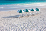 Tropical beach with umbrellas