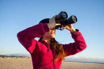 Ecologist Woman Watching the Environment with Binoculars
