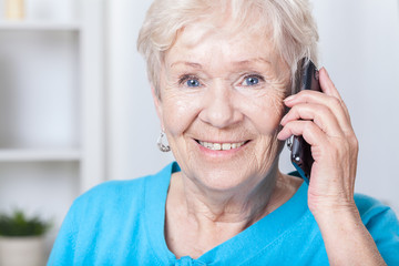 Senior lady talking on cellular phone