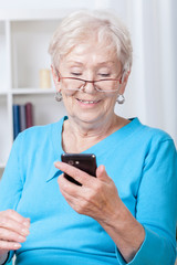 Elderly woman using mobile phone