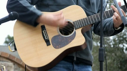 Guitar Being Played Outside Closeup