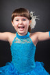 Portrait of cute smiling little girl in princess dress
