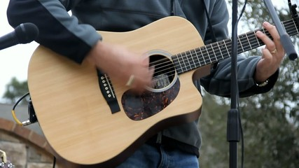 Guitar Played Outside By Male Hands