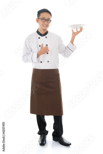Asian male chef holding a plate