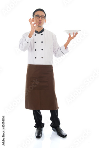 Asian chef holding a plate