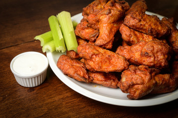 Chicken Buffalo Wings with Celery Sticks and Blue Cheese Dressin