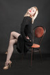slender blonde on a chair