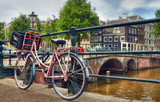 Pink Parked Bicycle Beside a Canal in Amsterdam