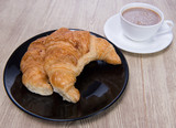 Fresh and tasty croissant with coffee