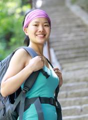 woman hiker climbing steep stone stairs on mountain huashan peak