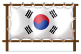 A wooden frame with the flag of Korea