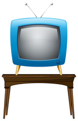 A blue television above the wooden table