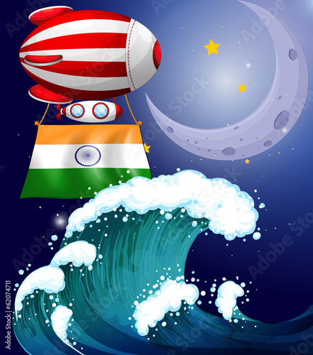 A balloon with the flag of India above the giant waves