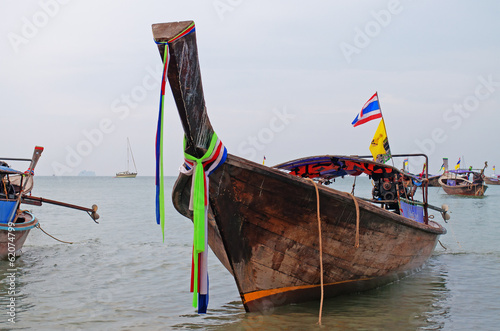 Traditional longtail boats on the Ao Nang beach at morning