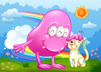 A pink monster and a cat at the hilltop with a rainbow in the sk