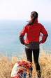 woman hiker enjoy the view on seaside mountain peak