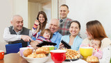 Happy multigeneration family  with electronic devices
