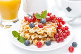 delicious breakfast with Belgian waffles and fresh berries