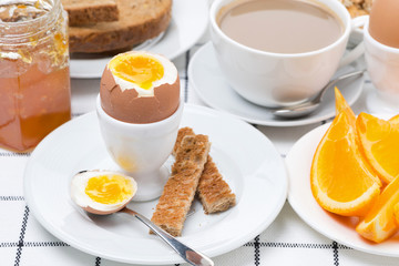 fresh breakfast with eggs, toast and coffee with milk