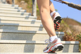 sports legs running up on stairs to mountain peak