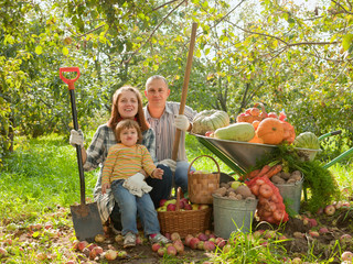 Happy parents and child with   vegetables