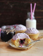 Cupcakes with blackcurrant jam, coconut and pink syrup