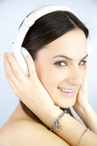Closeup of woman listening music with headset