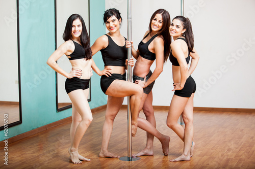 Group of pole dancers having fun