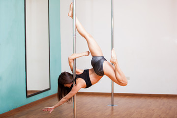 Sexy pole dancer showing off