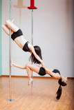 Pole dancers working out together