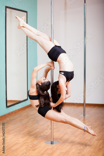 Pole dancing beautifully together