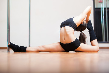 Stretching in pole fitness class